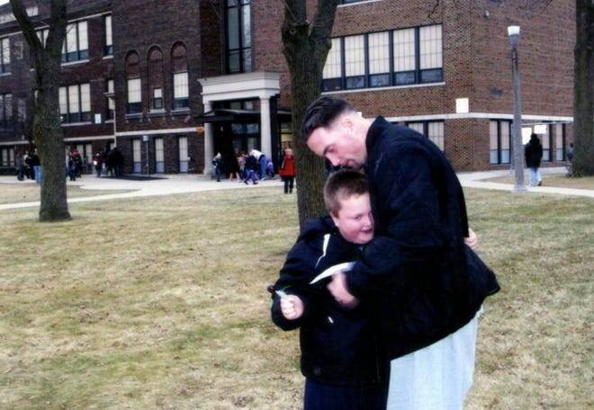 Jeremy Cunningham hugs his son, Jaden Cunningham. Jeremy Cunningham's mother, Cynthia Telford, hoped that while her son was in custody he could get treatment for drug and alcohol addiction. Credit: family photo