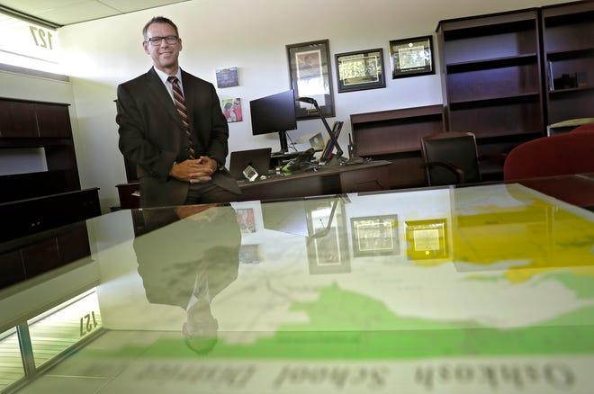 Oshkosh Area School Superintendent Bryan Davis poses for a photo Friday in his office in Oshkosh.