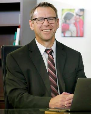 Oshkosh Area School Superintendent Bryan Davis poses for a photo at his desk Friday, July, 2, 2021, in Oshkosh.