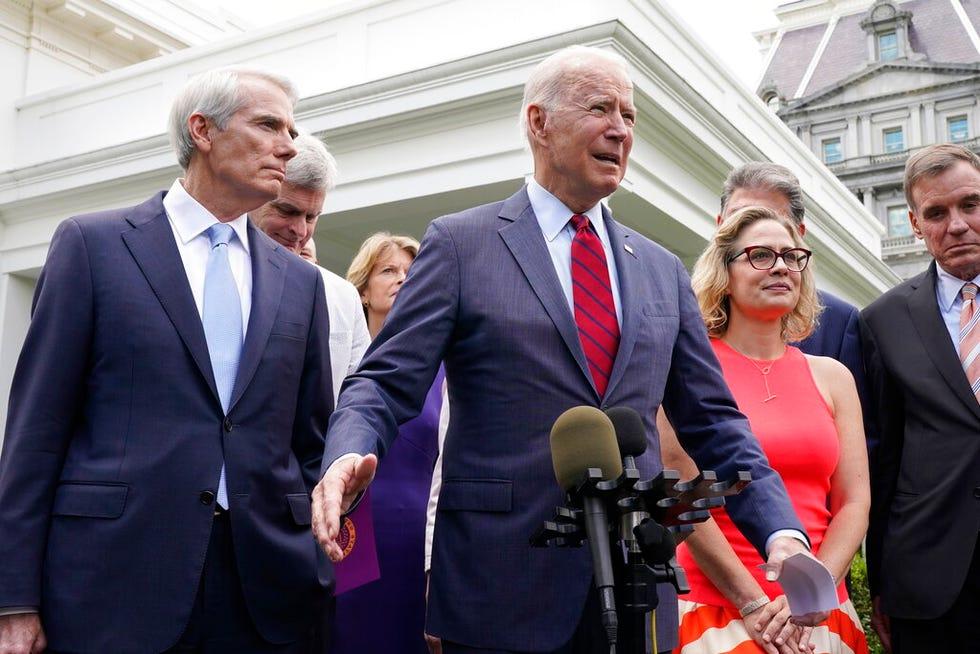 President Joe Biden, with a bipartisan group of senators, speaks June 24, 2021, outside the White House. Biden invited members of the group of 21 Republican and Democratic senators to discuss the infrastructure plan. From left are, Sen. Rob Portman, R-Ohio, Sen. Bill Cassidy, R-La., Sen. Lisa Murkowski, R-Alaska, Biden, Sen. Joe Manchin, D-W.Va., rear, Sen. Kyrsten Sinema, D-Ariz., and Sen. Mark Warner, D-Va.