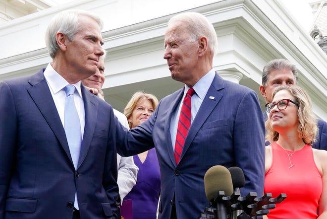 President Joe Biden speaks with Sen. Rob Portman, R-Ohio, and other bipartisan group of senators, Thursday June 24, 2021, outside the White House in Washington.