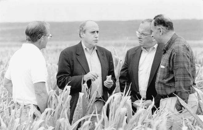 Then-Secretary of Agriculture Dan Glickman visits a corn farm during a drought in upstate New York with Senator Chuck Schumer (far right), former congressman Tom Reynolds, and an unidentified New York state farmer in 1997.