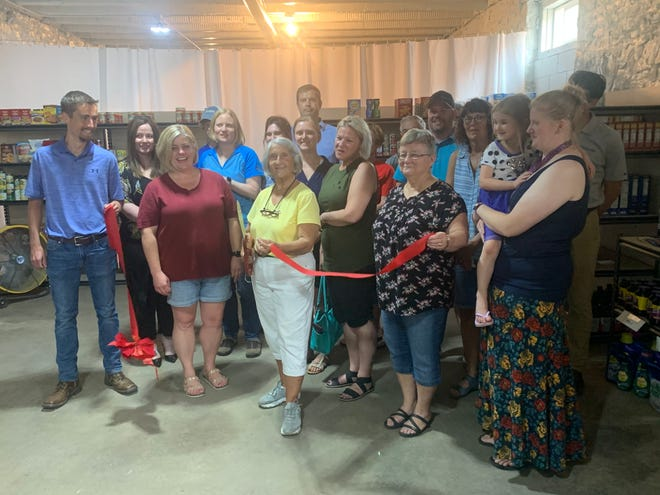 Dell Rapids community leaders joined the Storehouse Food Pantry board members at a ribbon cutting of its new location on Wednesday, June 16, 2021.