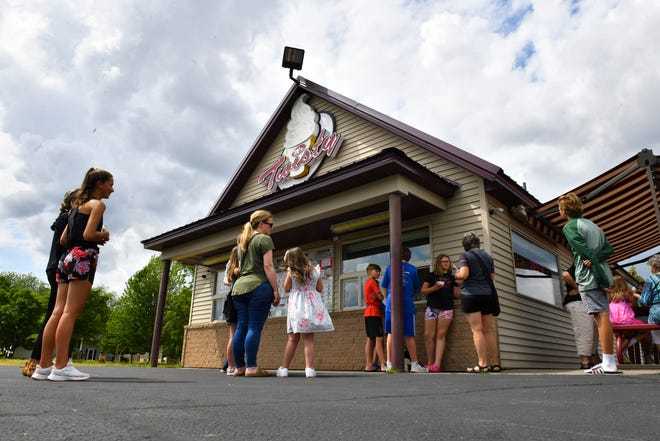 People line up for ice cream creations at Mr. Twisty Monday, June 28,  2021, in St. Cloud.