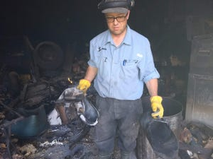 Cherith Brook Farm goes through burned and melted butchering equipment after a fire burns down the shop.