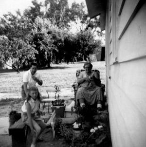 Aunt Leona Brush, Grandma Vera Brush, and Susan in the foreground, from July 1960.