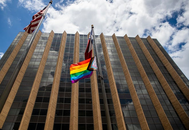 A Pride flag is flown at the Travis County Administration Building on June 29. [RICARDO BRAZZIELL / AMERICAN-STATESMAN]
