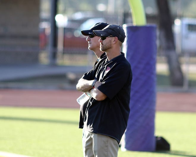 Vista Ridge football coach Chad Scott, in front, watches a practice during the 2020 season along with former head coach Rodney Vincent. An assistant for 12 years with the Rangers, Scott takes over the Vista Ridge program after Vincent left for Shallowater in West Texas. Scott and Cedar Park's Michael Quintero were approved as head coaches at their respective schools at the Leander school board meeting Tuesday.