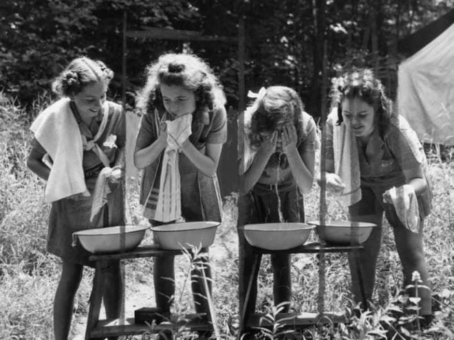 Girl Scouts wash up in 1941 at Camp Crowell in Richfield.