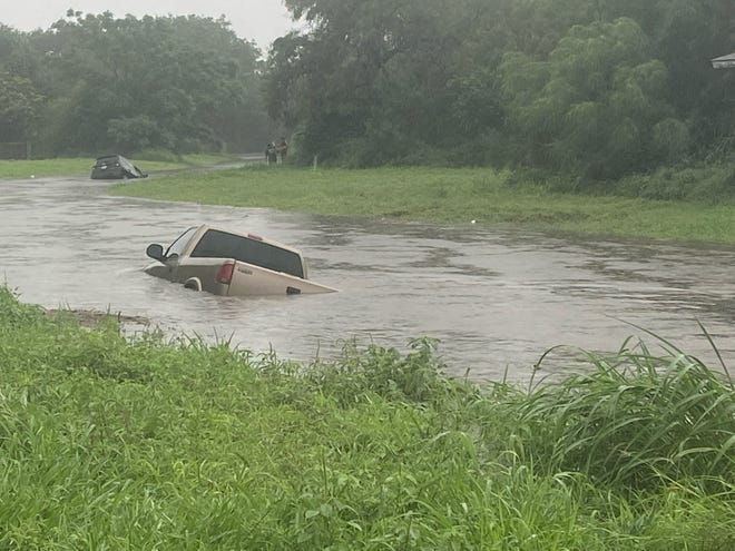 Two vehicles were submerged in a creek on North Stadium.