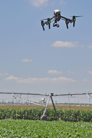 A drone flies above the irrigation research farm north of Yuma. As drone applications expand, universities are creating programs to facilitate training and research. At the CSU Drone Center in Fort Collins, students are certified in drone operation and often assist with research programs in agronomy and resource management.
