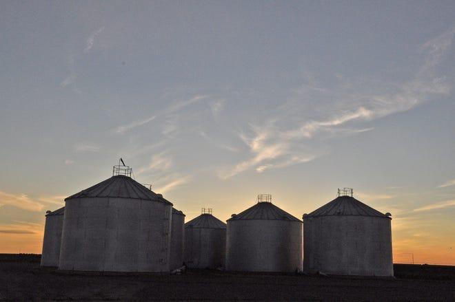 Grain bins at sunset.