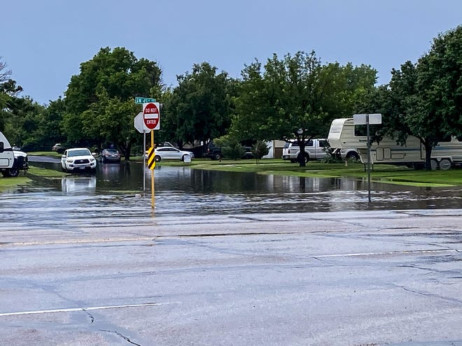 """High water is seen at Western Street and 45th Street in Amarillo following heavy rain showers in the area Wednesday.  Multiple streets were flooded across town, leading to slowdowns and some closed roadways, especially in areas of southwest Amarillo and along I-40 where about 1-3"""" of rain fell, according to the National Weather Service Amarillo office."""