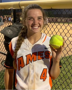 Ames shortstop Ellie Lynch holds up her home run ball after going deep in the second game of a softball doubleheader with Ankeny Tuesday at Ankeny. The Little Cyclones dropped both games, 11-9 and 13-2, to fall to 19-19 on the season.