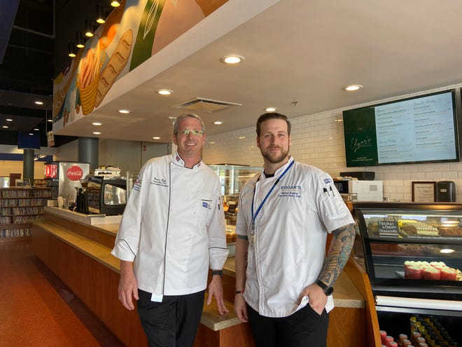 Bruce Ozga (left) and Michael Romano (right) stand in front of Edgar's Bakehouse. The new bakery is a part of the Edgar's Hospitality Group.
