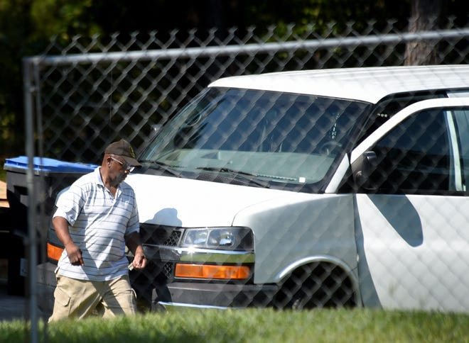 Augusta Commissioner Sammie Sias secures his van after FBI agents searched it during the raid of his Hephzibah home in 2019.