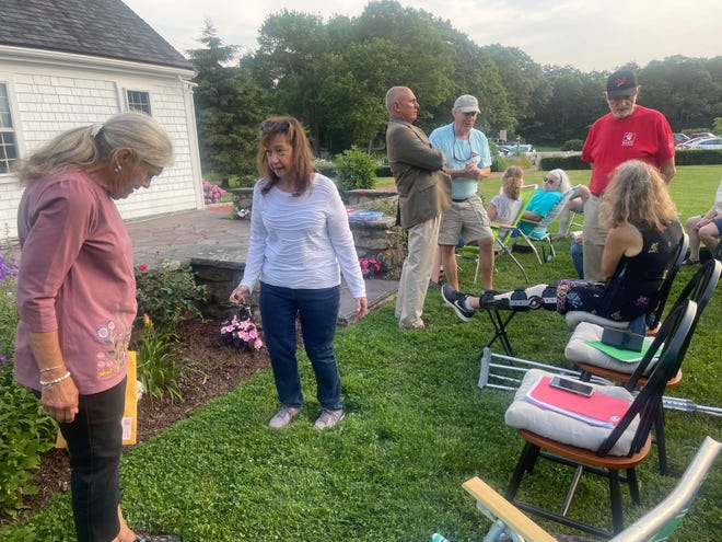 """MMVA President Donna Lawson and VP Debbie Lavoie survey the Burgess House lawn and garden Tuesday evening. """"This (beauty) doesn't just happen,"""" Lawson said. """"I'm here every day."""""""