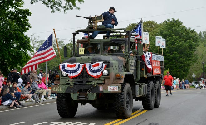 The United Cape Patriots vehicle, driven by Adam Lange, rolls down the parade route Sunday in Orleans.