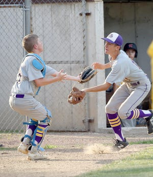 Pilot Grove catcher Alec Schupp and third baseman Hayden Sleeper collide while attempting to catch a foul ball in the second inning Tuesday in Jr. Babe Ruth.