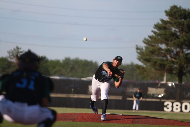 The Cannons pitcher warms up in a game in the Kansas Collegiate Baseball League