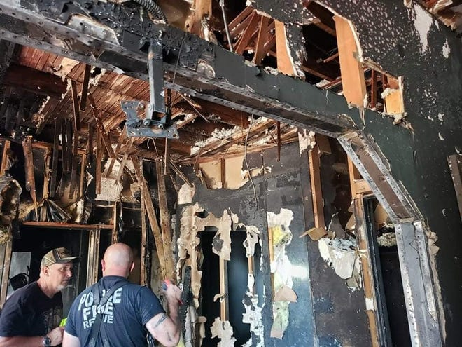 Augusta Fire Department examine the fire damage at the apartment