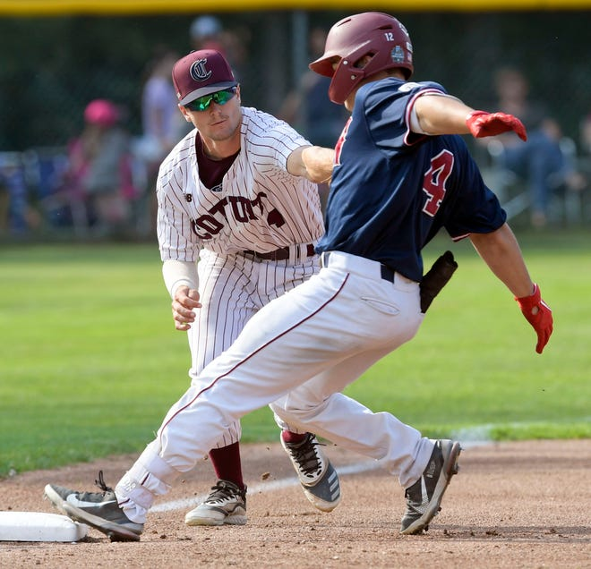 Tommy Troy of Wareham arrives safely at third ahead of the tag by Cole Cummings of Cotuit. Wareham won on Tuesday, 5-2.