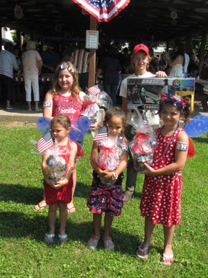 Winning entrants in the Lewistown Bicentennial children's parade include (from left): Front row, from the left, Opal Sheets, Kailee Young, Gracelyn Flaharty;  Back, Ariane Fuller, Colton Picton.