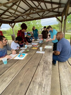 Camp Big Sky recently received the Community Art Grant for their Accessible Art in Nature program. This program has been made possible by a grant from the Community Foundation of Central Illinois. Pictured are SRC students helping campers.
