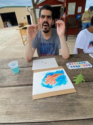Camp Big Sky received the 2021 Community Art Grant for their Accessible Art in Nature program. Pictured is Robert.
