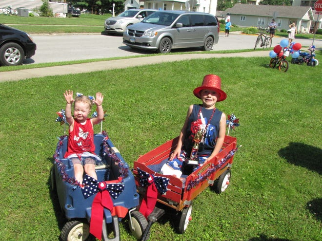 Two participants relax after the parade in Lewiston as they listen to music and enjoy treats.