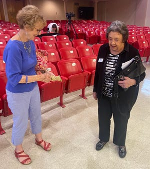 Lynnanne Baumgardner, left, a founder of the Columbia Public Schools Foundation, talks with foundation President Cindy Mustard on Wednesday at Jefferson Middle School after a $1 million donation to the foundation was announced.