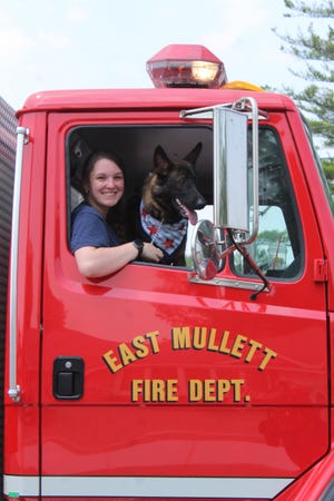 Becca Kauffman and her German Shepherd puppy Shiloh were a crowd favorite at the Indian River Fourth of July Parade on Sunday, riding in one of the East Mullett Fire Department trucks.