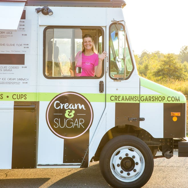 Rachel Upton in the ice cream cart for Cream and Sugar, a West Side ice cream parlor.