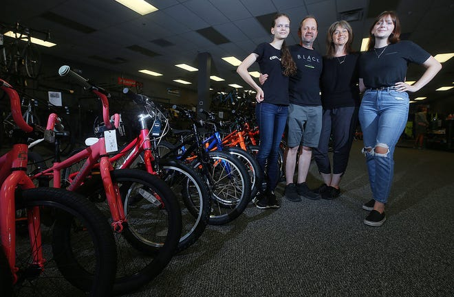 Bicycle One, at 358 S. Hamilton Road, Suite F, in Gahanna, is owned by the Frazier family, (from left) Lily, Troy, Jane and Caroline, pictured at the shop July 1.