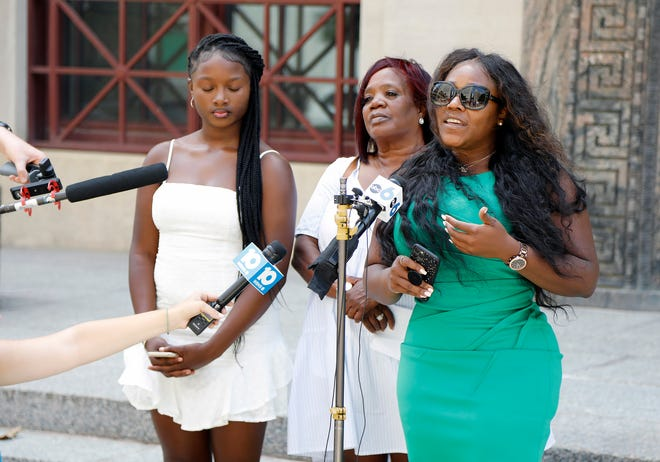 Michelle Martin, right, attorney for Ma'Khia Bryant's family, speaks to the media after Ohio Attorney General Dave Yost announced Wednesday that BCI had finished the investigation into the shooting death of Bryant. The family spoke at City Hall. Also speaking during the press conference was Bryant's grandmother, Jeanene Hammonds, center, and Bryant's sister Ja'Niah Bryant, left.