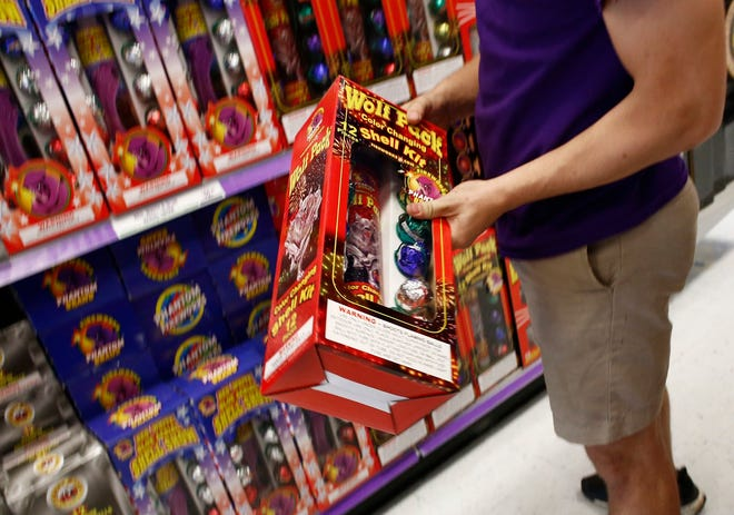A Phantom Fireworks employee stocks shelves in the Millersport store in 2018.