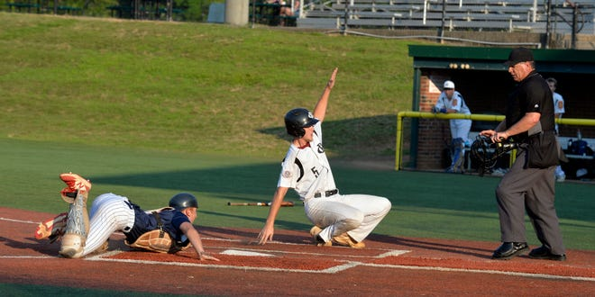 Randolph County's Blake Marsh scores a run after sliding around a tag against High Point on Tuesday at McCrary Park. [Mike Duprez/Courier-Tribune]