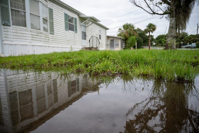 Rain flooded a road in Eustis after Hurricane Elsa on Wednesday morning. [Cindy Peterson/Correspondent]