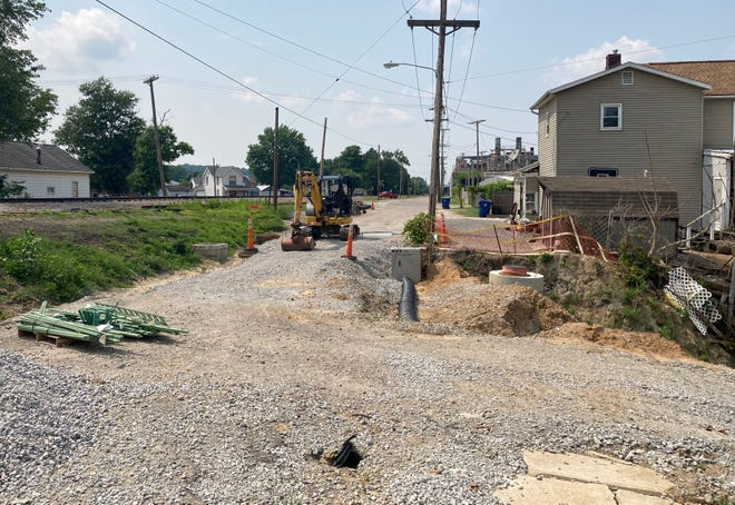 Guernsey County commissioners authorized revocation of a $428,792 bond for the Glass Avenue culvert replacement project in Byesville after contractor Amaazz Construction of Ohio LLC failed to meet a June 30 deadline for completion of the work.