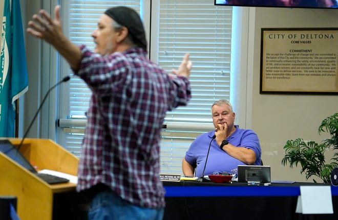 John Peters III, acting city manager of Deltona, listens as resident Elbert Bryan addresses the City Commission from the podium during a meeting on June 7, 2021.
