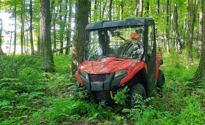 An ATV cruises down a trail June 5 in Somerset County. The DCNR is starting a pilot program in northcentral Pennsylvania to provide more trails and roads for ATV enthusiasts.