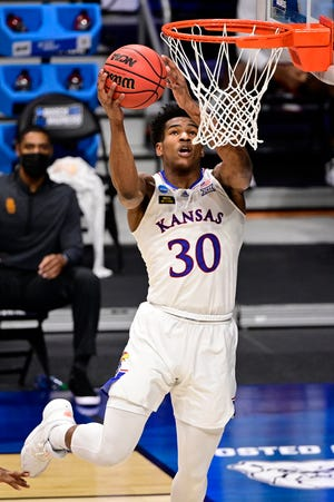 Kansas guard Ochai Agbaji (30) goes up for a shot in the NCAA Tournament this year. Agbaji, an Oak Park High School graduate, has decided to forego the NBA Draft and return to the Jayhawks for the 2021-22 season.