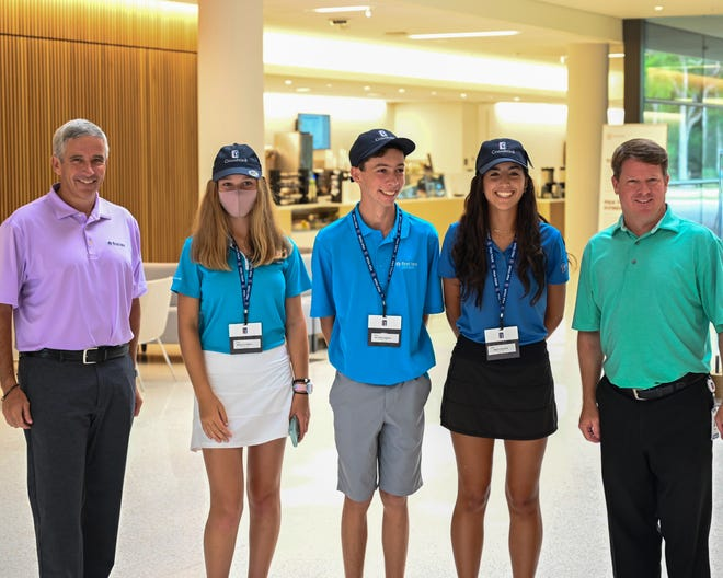 PGA Tour commissioner Jay Monahan (left) and PGA Tour Champions president Miller Brady (right) gave three First Tee-North Florida members the news that they will play in the PURE Insurance Championship at Pebble Beach in September. From the left are Madelyn Campbell, Matthew French and Grace Richards.