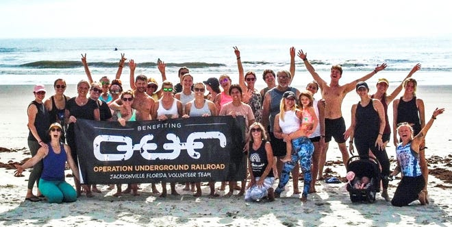 The second annual Yoga on the Beach benefit drew about 20 supporters to raise money for Operation Underground Railroad, a group that fights child trafficking.