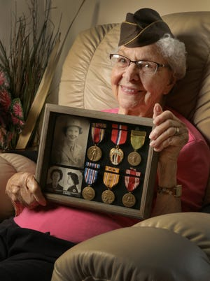 Penney Farms resident Winnie Mills, shown with her original uniform cap, served during World War II in the Women's Army Corps.