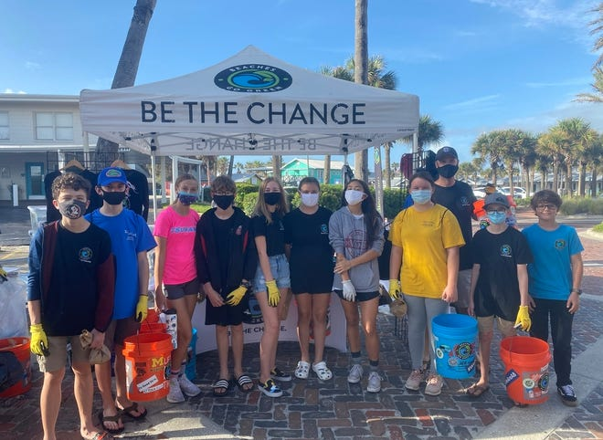 Members of the Fletcher Middle School Beaches Go Green Club are pictured during a recent cleanup event. The students were recognized with a 2021 Green Apple award for environmental education by the U.S. Green Building Council.