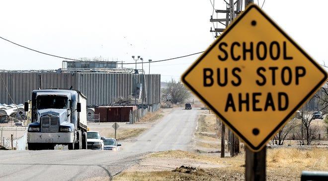 Motorists make their way along Farmland Road between Mansfield Road and U.S. Highway 50.