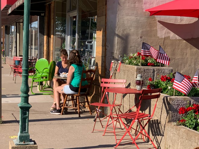 Joetta Smith and Star Hull of Monmouth make use of outdoor seating at Tin Cup, 226 S. Main St., in June of last year. The city will rescind temporary outdoor seating permits for bars and restaurants offered during the pandemic, but offers a permanent option through a cafe ordinance.
