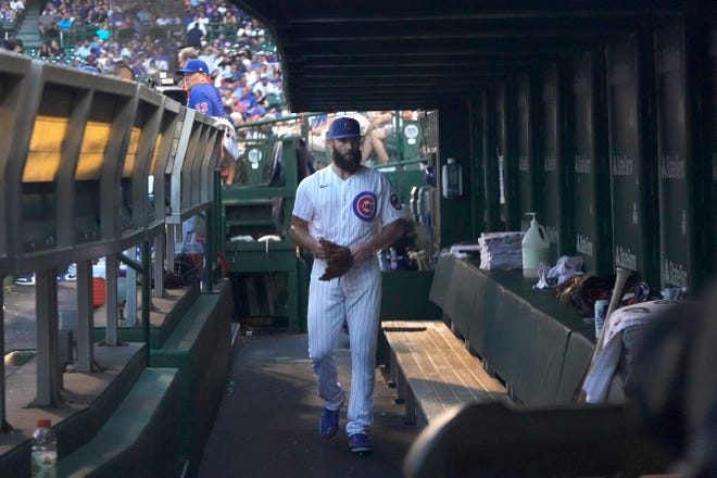 Chicago Cubs starting pitcher Jake Arrieta walks through the dugout after manager David Ross pulled him during the second inning of a Tuesday's game against the Philadelphia Phillies, in Chicago.