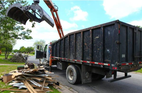 Crews with Sherman's Solid Waste department collect bulk waste in this shot from 2016. The city's bulk trash program has since become a heavy burden for code enforcement officials.